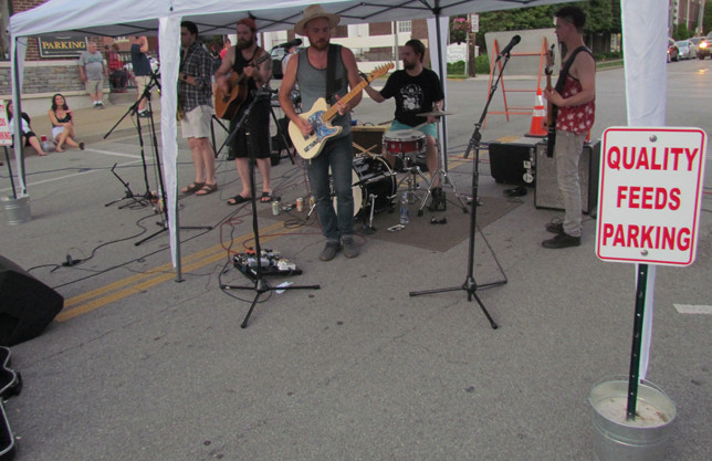 """TRIPPIN' ROOTS provided a """"quality"""" soundtrack at the first Friday Night Block Party. The local band was profiled in the Sun in February 2018. (Photo by John McGary)"""