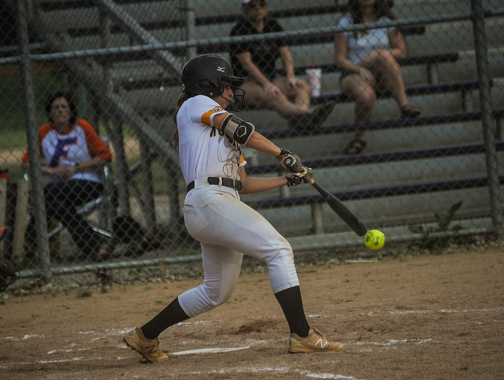 WCHS SENIOR PEYTON ROSE rips a single in the Lady Jackets' win over Frankfort in the district semifinal on May 21. (Photo by Bill Caine)