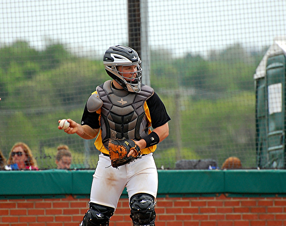 CHARLIE CORUM has been a big asset for the Woodford County High School baseball team. The sophomore catcher's defense behind the plate and his timely hitting has been instrumental in helping the Bat Jackets clinch the 41st District regular season title. (Photo by Rick Capone)
