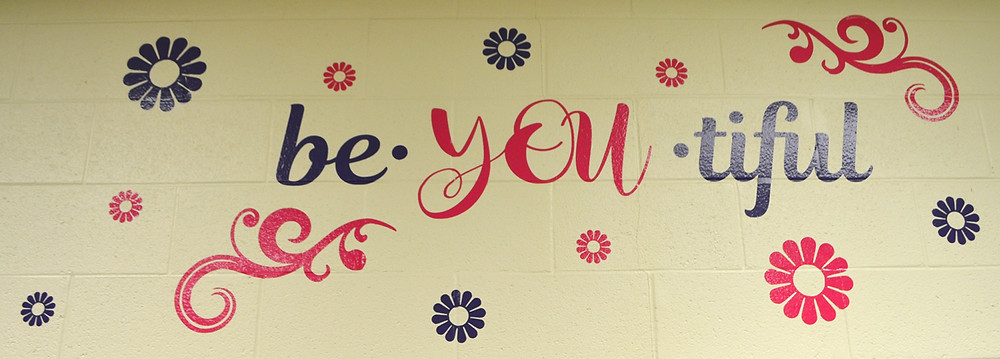 EMPOWERING WORDS and messages were added to the newly-painted walls in the girls' bathrooms at Woodford County Middle School. WCMS parents and teachers worked tirelessly last Wednesday - one day before classes started in Woodford County Public Schools - to finish the walls. (Photo by Bob Vlach)