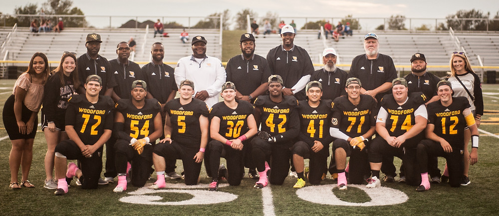 """WOODFORD COUNTY HIGH SCHOOL football senior night was celebrated at Community Stadium on Oct. 6 for members of the WCHS football team and also members of the training staff and senior water girl. Front row, from left, are Jack Hill, Jaylan Washington, Dawson Switzer, Dawson Dearing, Jayden Hamilton, David Martinez, Omar Renteria, Zack """"Bobo"""" Case and Brody McCoun; back row, Mara Liorente, Carrie Collins, coaches John Logan, Chad Vaughn, Sam Roley, Craig Smith, Derrick Johnson, Dennis Johnson, Bob Crouch, Keith Brown, Ashton Bailey and Kennedy Eden. (Photo by Bill Caine)"""