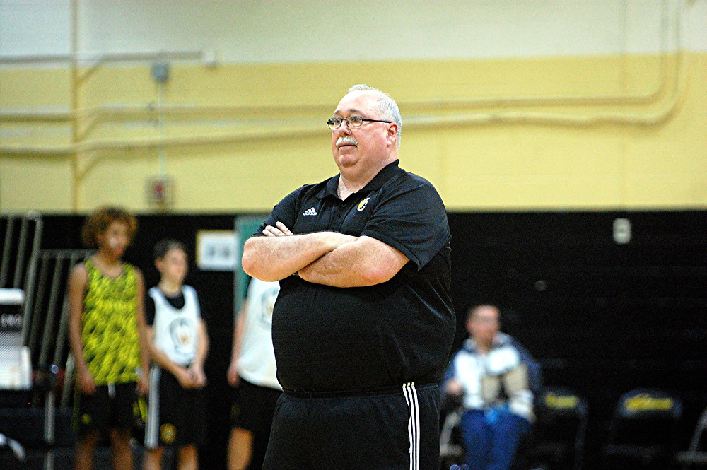 SCENES FROM the WCHS girls' basketball scrimmage during Jacket Madness on Friday, Nov.  18 in The Hive. WCHS head coach Jay Lucas watches his players warm up. (Photo by Rick Capone)