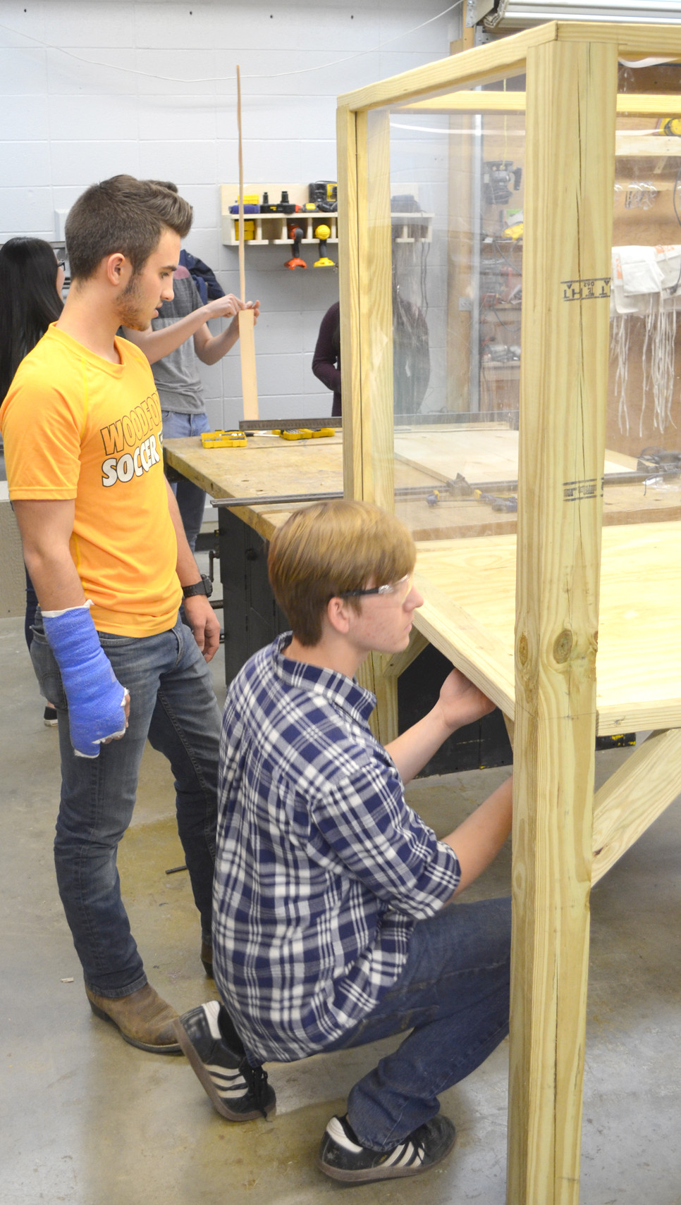 MAX LIPPERT, left, and Evan Williams worked on one of the Invisible Cities informational booths for Spark Versailles. The downtown festival comes to Versailles on April 8, 9 and 10. (Photo by Bob Vlach)