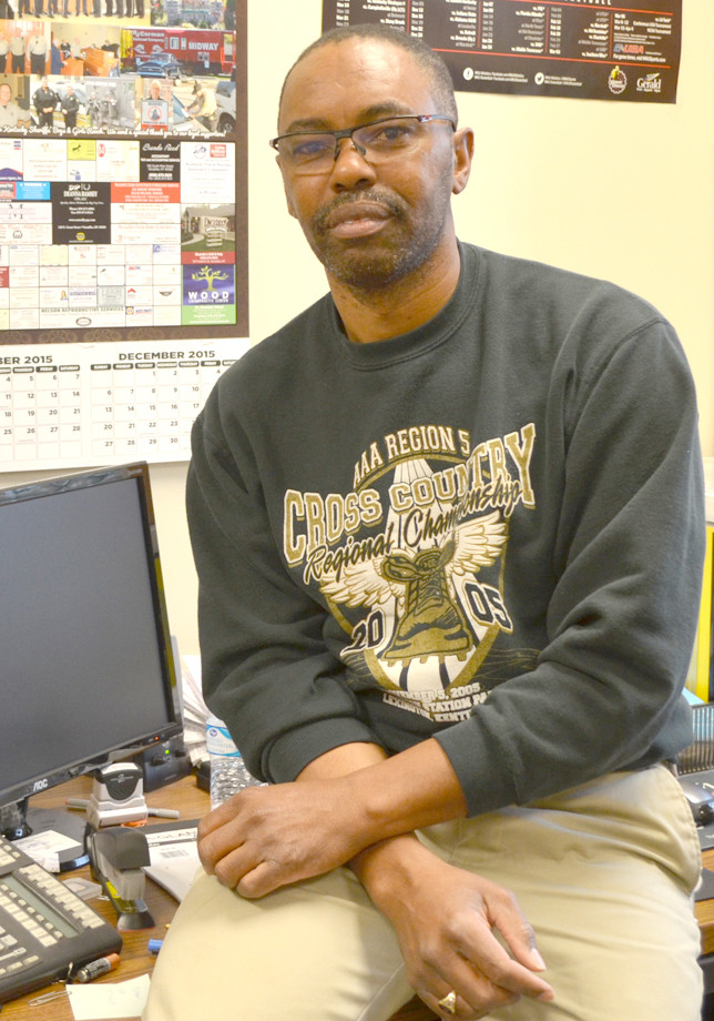 ISAAC HUGHES was hired as building official/inspector in Woodford County last April. He regularly takes his camera with him whenever he leaves the office to do an inspection. Hughes succeeded longtime building inspector Paul Noel Jr., who retired last year. (Photo by Bob Vlach)