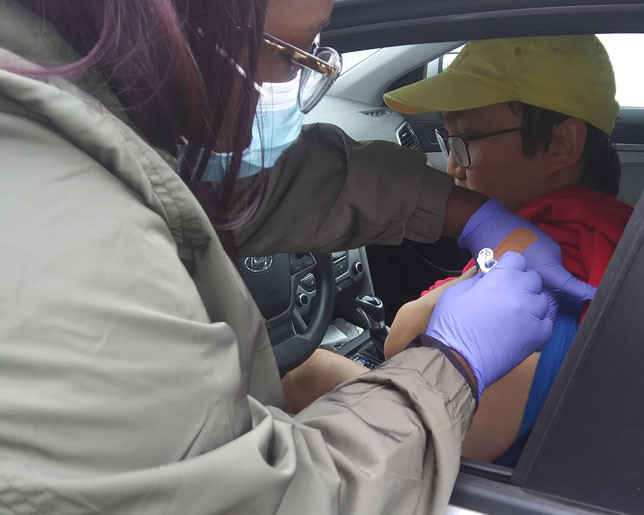 JACKSON MCKEE  was one of 131 people who received free flu shots at a drive-thru vaccination clinic Oct. 28 outside the Huffman Pavilion at the Woodford County Park. (Photo by John McGary)