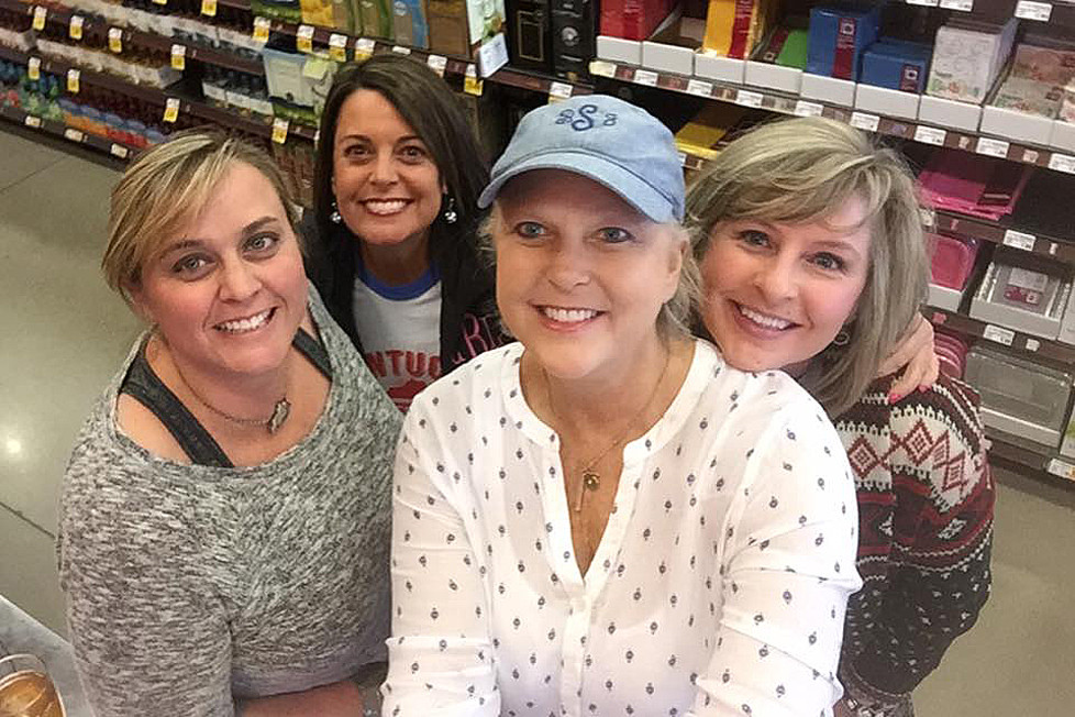 """WOLFPACK MEMBERS, from left, Joy Farmer, Carol Broughton, Becky Selby and Allison Gentry, don't always wear their pink """"Still Saving Second Base"""" t-shirts to Pint Night at Kroger. The quartet has lived within a block of each other for a dozen years, and Farmer, Broughton and Gentry have made Selby's nearly three-year battle with breast and lung cancer easier - and funnier. (Photo by Becky Selby)"""