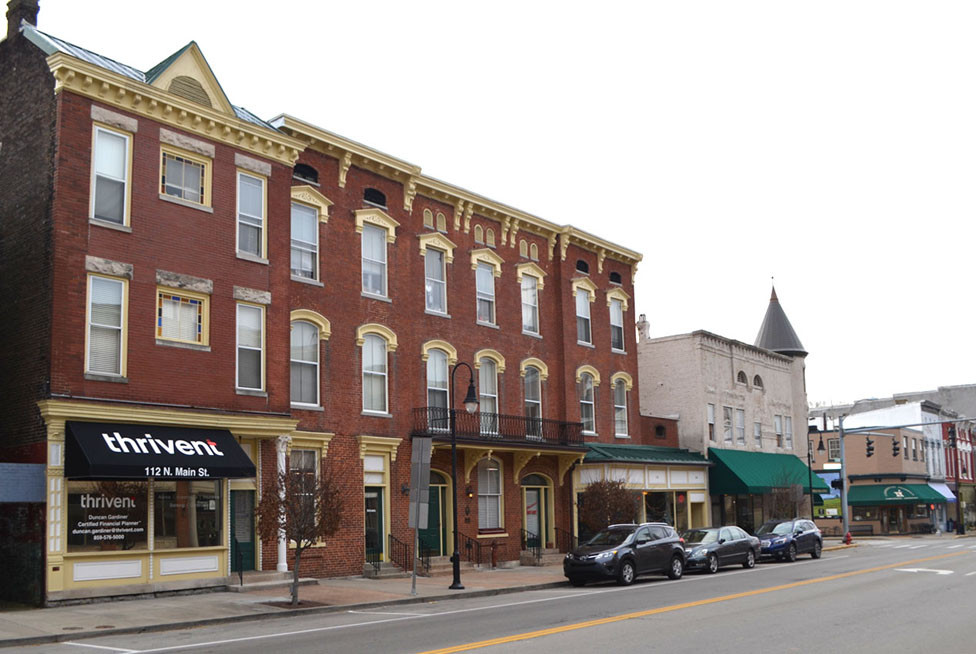 THIS HISTORIC THREE-STORY BUILDING on North Main Street, where the old Woodford Hotel was located, has been sold for $700,000. Jon G. Hall and Lindsey Dempsey-Hall sold the building to Eric Carrico, as manager of Katy Ashford, LLC, according a deed filed in the Woodford County clerk's office. Carrico plans to offer short-term rental apartments in the upper two floors of building. Businesses occupy the first-floor storefronts. (Photo by Bob Vlach)
