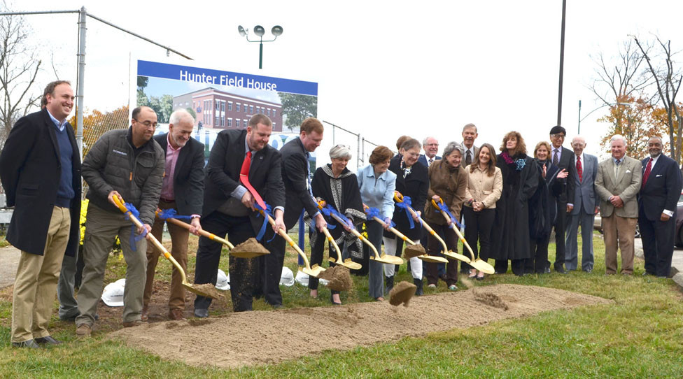 THE BOARD OF TRUSTEES at Midway University joined President Dr. John Marsden and newly-reelected Midway Mayor Grayson Vandegrift at a groundbreaking ceremony and name reveal for the Hunter Field House Nov. 8. From left are, front, Vandegrift, Nathan Sorrell, of Momentum Construction, Kevin Locke, of Ross Tarrant Architects, Rusty Kennedy, of Midway University and Marsden with trustees Donna Moore Campbell, Belinda Metzger, Jan Hunter, Anita Britton, Amy Wickliff, Linda Green, Libby Jones; back, Bob Hutchison, Dr. Jim Roach, Dr. Suvis Desai, Rusty Henbree, Larry Taylor and Keith Mathis. Not pictured, but also present were Jason Walton, of Momentum Construction, and trustee Ginni Fox. (Photo by Bob Vlach)