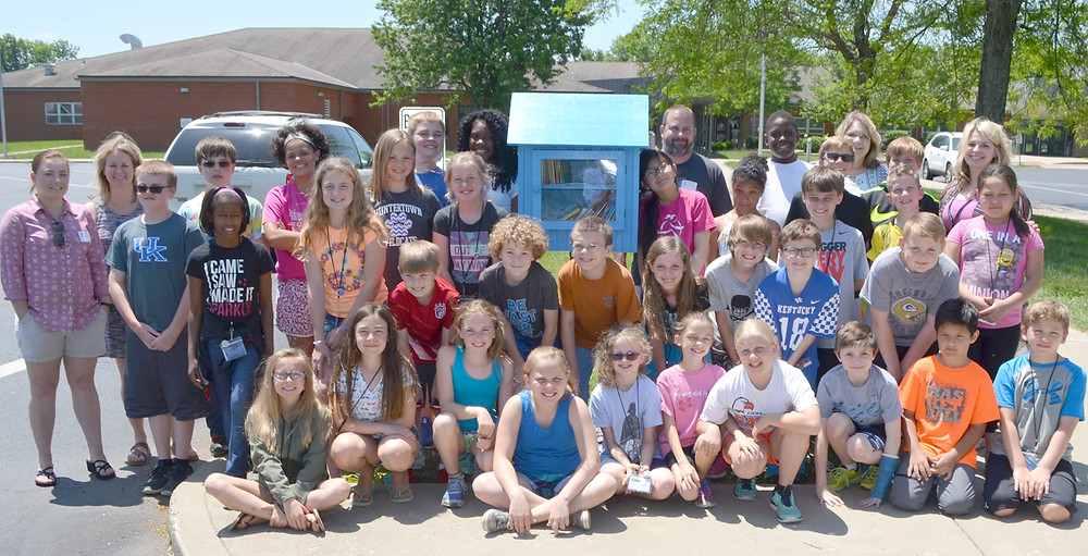 "K-KIDS GATHERED around Huntertown Elementary School's ""Little Free Library"" following a ribbon-cutting ceremony on May 16. By opening a Little Free Library, school guidance counselor Bianca Bargo said the entire community can get behind Huntertown's effort to promote reading in families. (Photo by Bob Vlach)"
