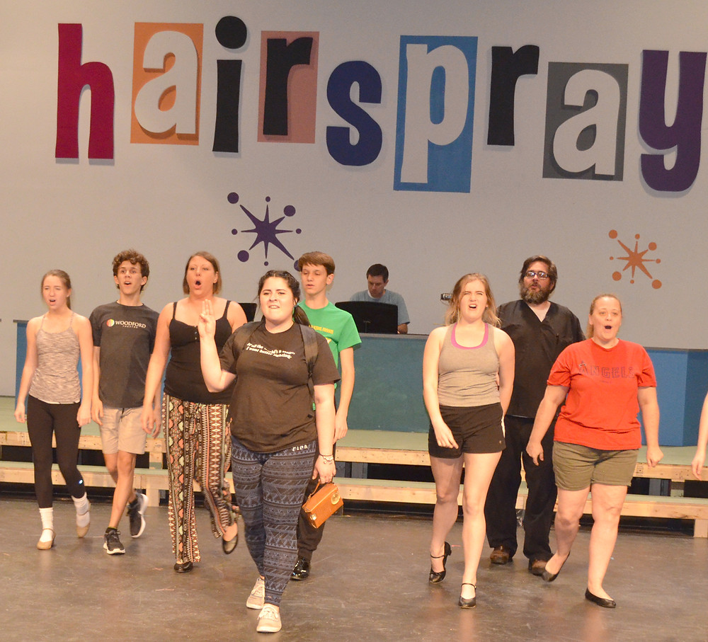 HAIRSPRAY opens at the Woodford Theatre next Friday night, May 6, at 8. Pictured, from left, are Abby Quammen (Tammy), Chap Hollin (Sketch), Amanda Kent (matron), Madeline Williamson (Tracy), Kevin Lausche (Brad), Sarah Hack (Brenda), Jonathan Watson (Spritzer) and Stephani Gilliam (gym teacher/Prudy) during a rehearsal on Monday night. (Photo by Bob Vlach)