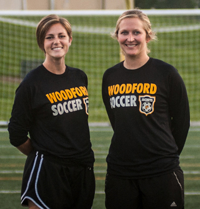 ANNE-SPICER ADAMS, left, is enjoying her first season as JV coach for girls' soccer at Woodford County High School. Assistant coach Elena Hitch is shown at right. (Photo by Bill Caine)