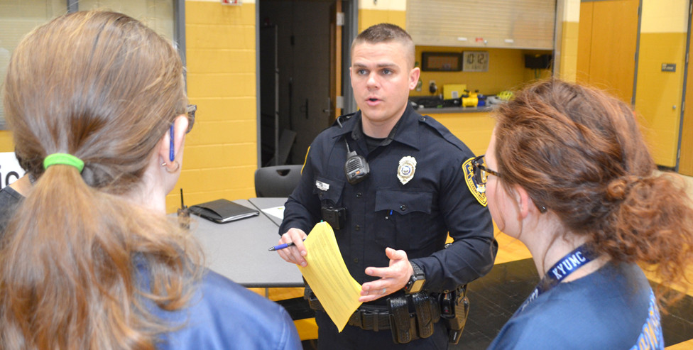 """VERSAILLES POLICE OFFICER Ben Hartley talked to eighth-grade students during """"Truth & Consequences: The Choice is Yours"""" at Woodford County Middle School. """"It's not only eye-opening for the students that are involved in this event,"""" said Elizabeth Coots, UK Extension agent for family and consumer sciences. (Photo by Bob Vlach)"""