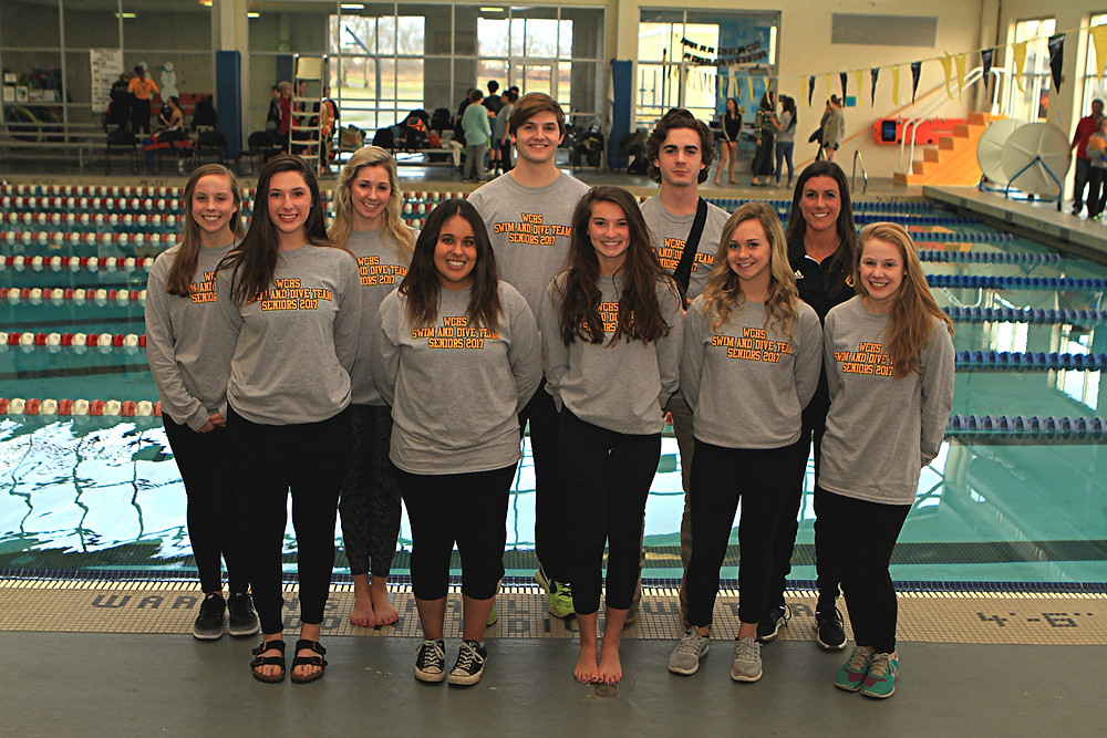 SENIOR CELEBRATION. On Wednesday, Jan. 25, the Woodford County High School swimming and diving teams honored their seniors after the meet against Scott County. Standing with head coach Blair Hicks, back row, far right, the seniors honored were, front row, from left, Sara Beth Shrader, Gabrielle Plata-Madrid, Reagan Jobe, Katie Beth Craig and Corey Tipton; back row, Mary Crutchfield, Eli Bradshaw, Tyson Robinson, and Grant Lewis. (Photo by Steve Blake/multiexposures.com)