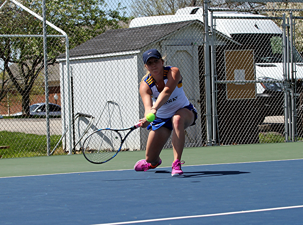 ELIZABETH TOTH, a sophomore on the Midway University tennis team, clinched the 5-4 victory over Carlow (Pa.) after she won her No. 3 singles match. Toth lost the first set, 7-5, but won the second and third set, 7-5 and 6-2, respectively, for the 2-1 win. (Photo courtesy of Midway Athletics)
