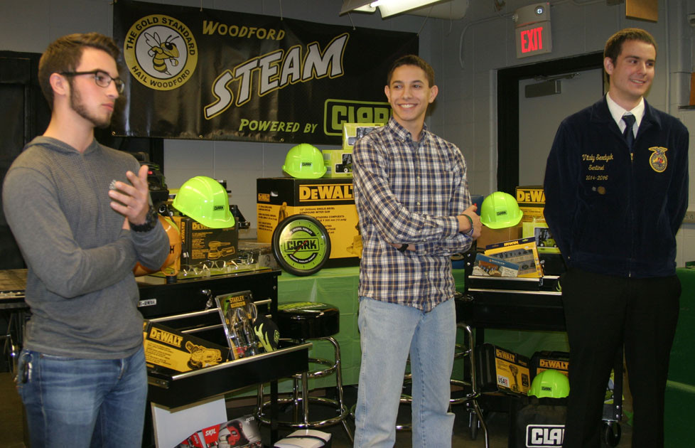 WCHS STEAM students, from left, Maxton Lippert, Victor Valdivia and Vitaly Serdyuk, shared their excitement over equipment worth $10,000 donated from Clark Materials for the school's manufacturing program. (Photo by John McGary)
