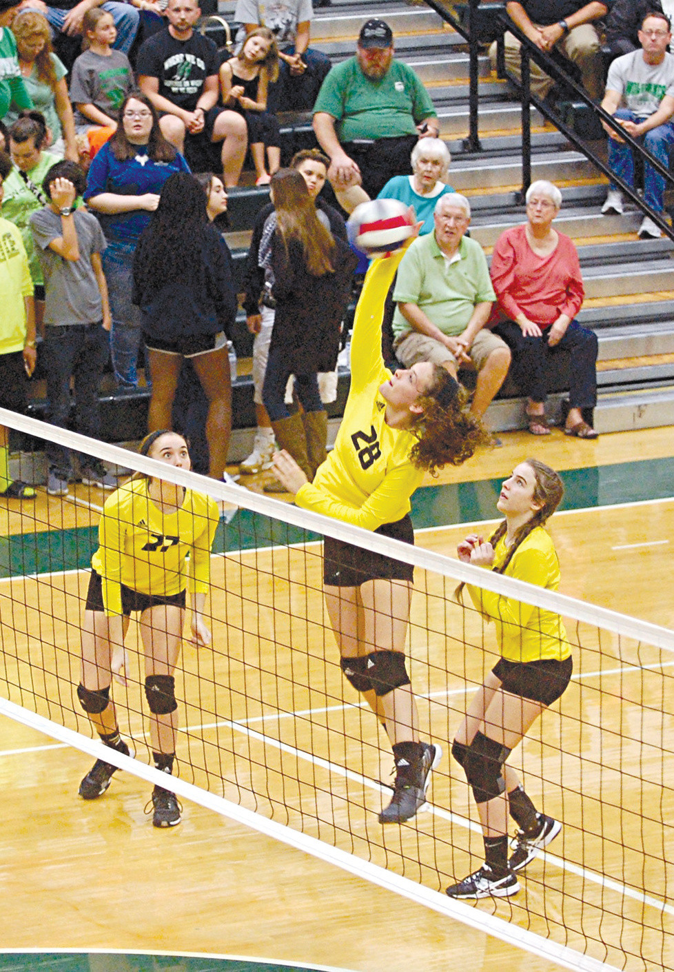 CALEIGH EVANS goes for a kill during the 41st District championship match between Woodford County High School and Western Hills on Wednesday, Oct. 19, at Western Hills. While the Lady Jackets lost 3-1, Evans was named to the All-41st District team for her efforts. (Photo by Rick Capone)