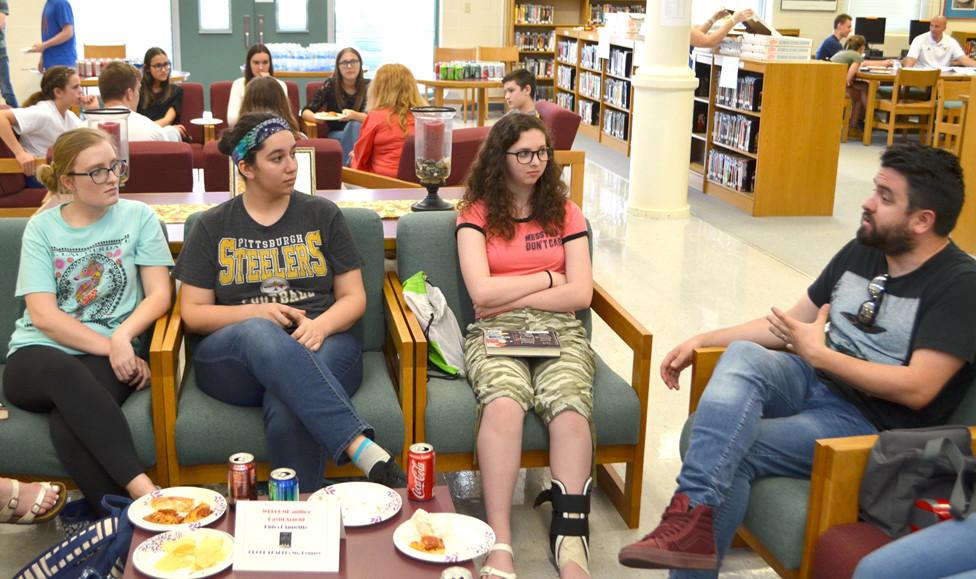 WCHS STUDENTS, from left, Aysia Pierce, Hunter Miranda and Shyann Kilfoyle listened to Lexington author David Arnold during last Thursday's Reading Extravaganza. (Photo by Bob Vlach)
