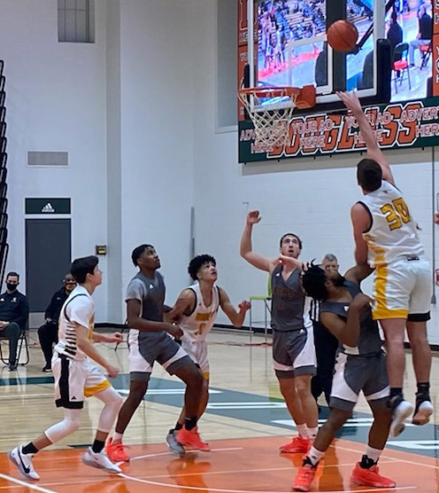 HUNTER PENN scored 13 points and came down with seven rebounds in the Jackets' 59-50 loss at Frederick Douglass Saturday. (Photo by Piper McCoun)