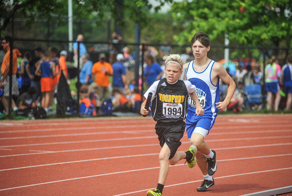 WCMS SIXTH-GRADER LANDON WETTLAUFER runs in the boys' 4x800-meter relay at the State Championship May 26. (Photo by Bill Caine)