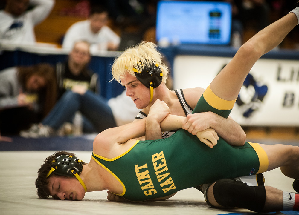 WCHS SENIOR ADAM BENDER dominated Saint Xavier's Nathan Ohlmann in the 113-pound weight class match at the state dual championship on Saturday, Jan.27. (Photo by Bill Caine)