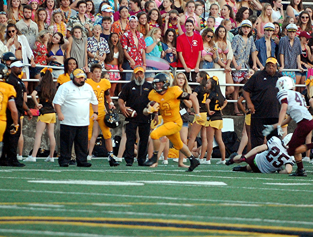 BRODY MCCOUN runs down the sidelines on a 31-yard gain off a fake punt during Woodford's 32-20 come-from-behind win over Marion County at home on Friday, Sept. 9. (Photo by Rick Capone)