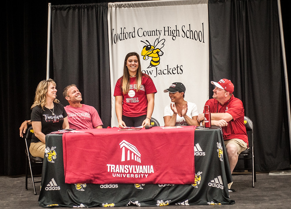 WCHS SENIOR BAILEE RAMNES signed her letter of intent to attend school and play softball for Transylvania University on Thursday, May 3. Pitcured from left: step-mother Kathy Ramnes, father Andy Ramnes, Bailee, mother Holly Land and step-father Chris Land. (Photo by Bill Caine)