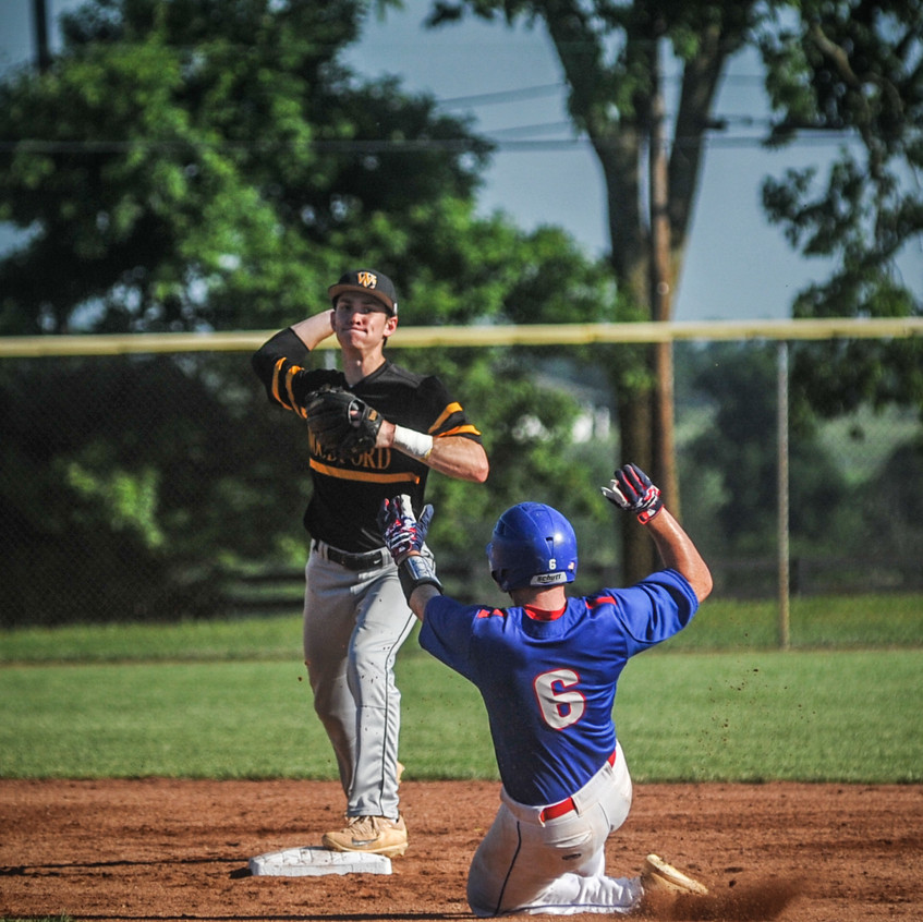 WCHS SENIOR CALEB MCNEELY turns a double play against Madison Central. (Photo by Bill Caine)