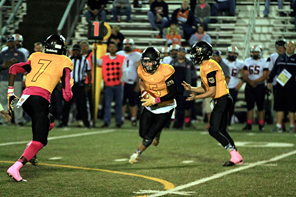 BEN BRUCKNER runs up the middle during the Woodford County High School football game against Madison Southern at home in Community Stadium on Friday, Oct. 14. The senior gained 50 yards on 11 carries in the game, but Madison Southern won, 49-7. (Photo by Steve Blake/multiexpoures.com)