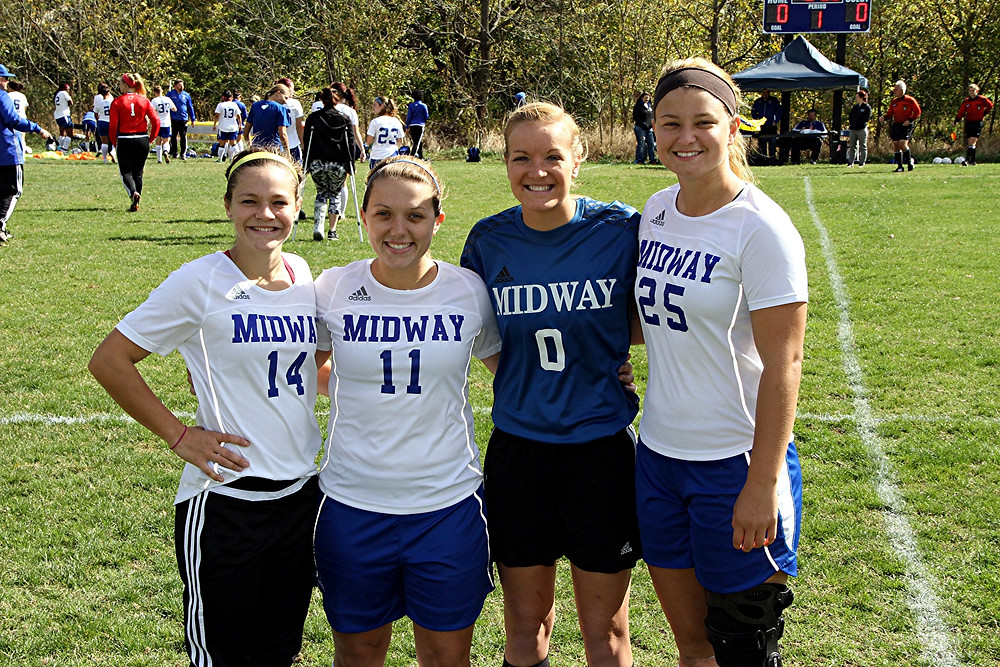 THE MIDWAY WOMEN'S SOCCER TEAM celebrated senior day on Saturday, Oct. 22, with an 8-0 win over Brescia University. The seniors are, from left, Tiffany Landrum, Haley Ennis, Lauren Schuster and Sara Herbert. (Photo by Midway Univ. Athletics)
