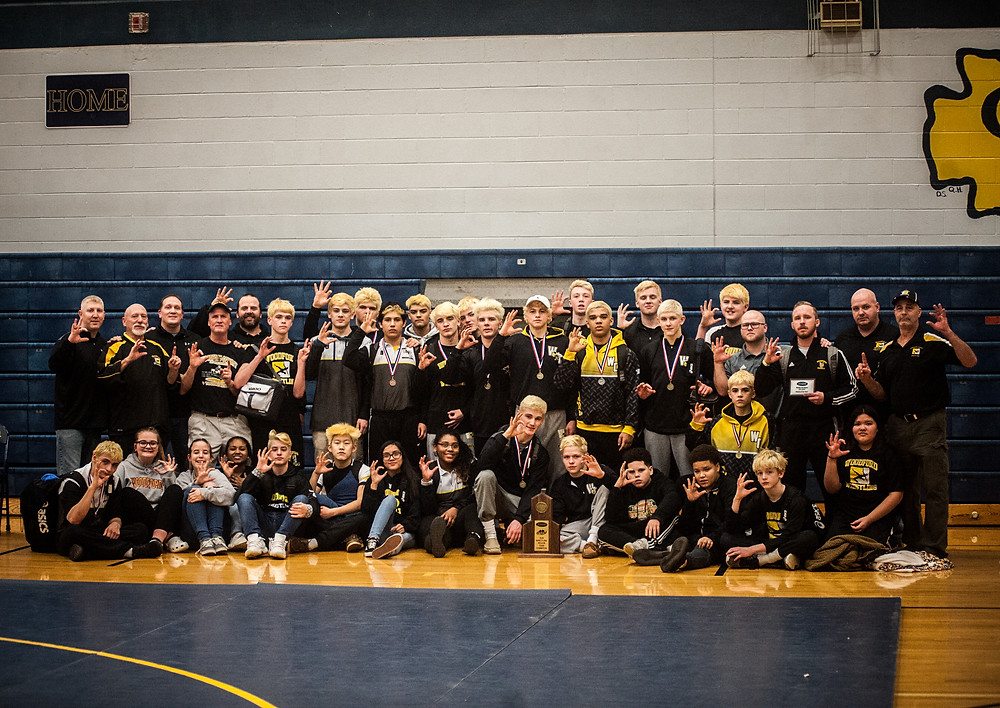 THE WOODFORD COUNTY HIGH SCHOOL WRESTLING TEAM won the Region 5 championship on Saturday, Feb 10 at Grant County High School in Dry Ridge. The Mat Jackets dominated the tournament advancing 12 wrestlers to the state championship and one alternate. (Photo by Bill Caine)