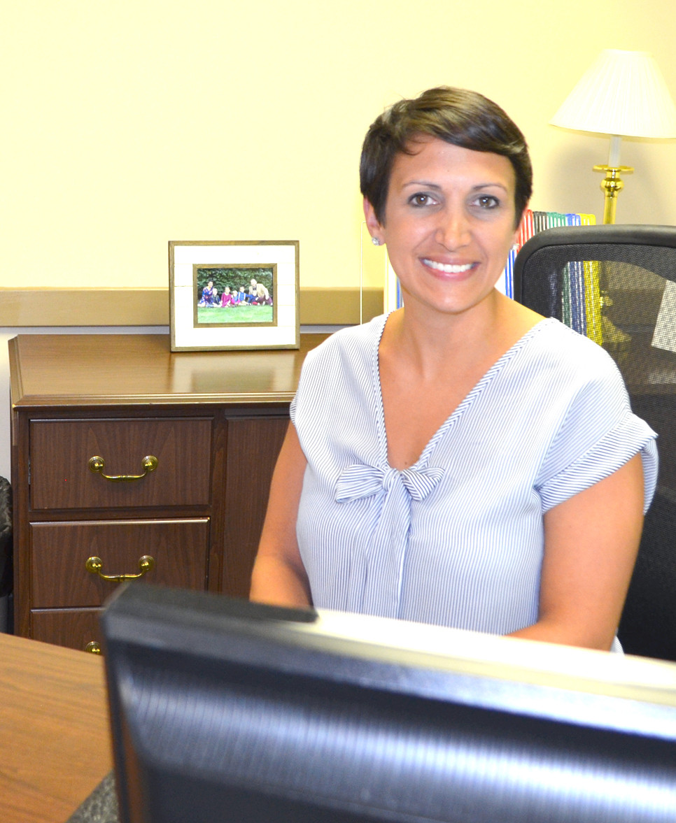 CASSIE PRATHER looks forward to getting to know people in the community and the public health needs in Woodford County in the coming months. The Mount Sterling native began her tenure as public health director at the Woodford County Health Department in January. She and her family moved to Versailles last month. (Photo by Bob Vlach)