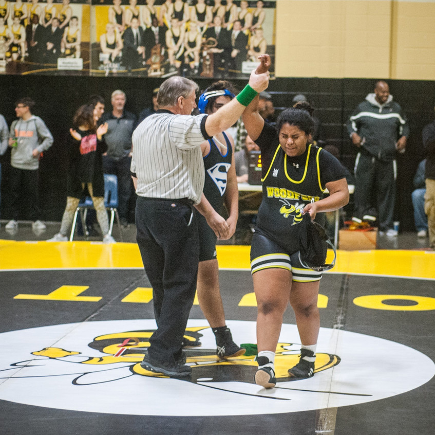 MAQUOIA BERNABE cries tears of joy after her victory in the consolation round at the Woodford County Invitational on Dec. 30. (Photo by Bill Caine)