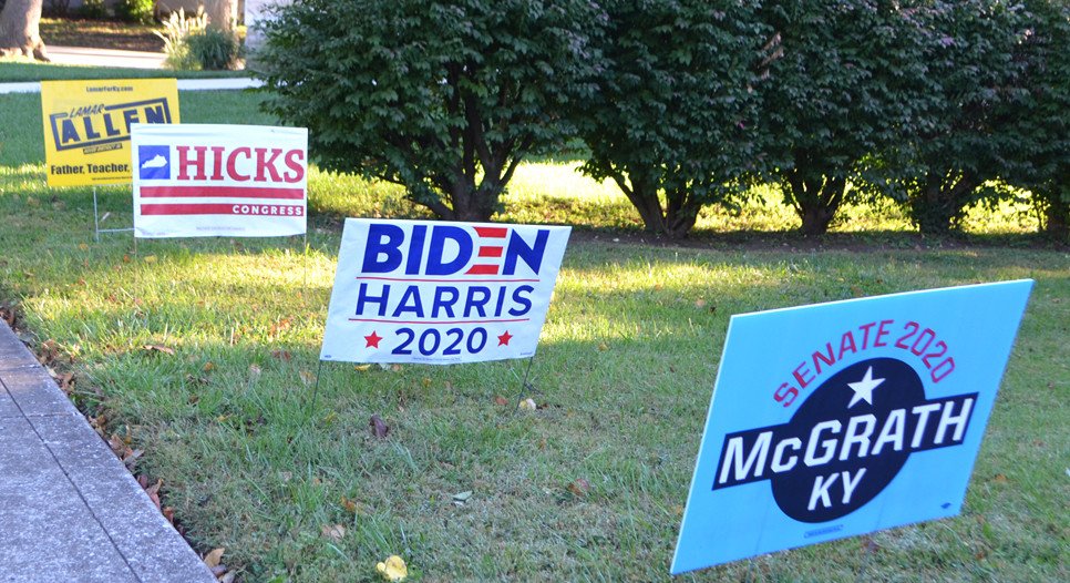 YARD SIGNS OF DEMOCRATIC CANDIDATES are pictured along South Winter Street in Midway. Asking somebody to put one of your signs in their yard is hard, but not as hard as asking for a campaign contribution, former Midway Mayor Carl Rollins said. (Photo by Bob Vlach)