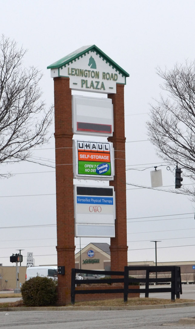 A COMING SOON SIGN atop the Lexington Road Plaza monument sign proclaims U-Haul's intentions to open a self-storage and rental facility in the shopping center where Kroger and Kmart were formerly its anchors. (Photo by Bob Vlach)