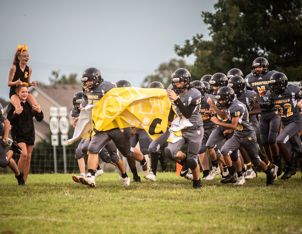 WCMS EIGHTH-GRADERS charged the field to start their final home game of the season. The Tigers lost 26-0 to Harrison County. (Photo by Bill Caine)