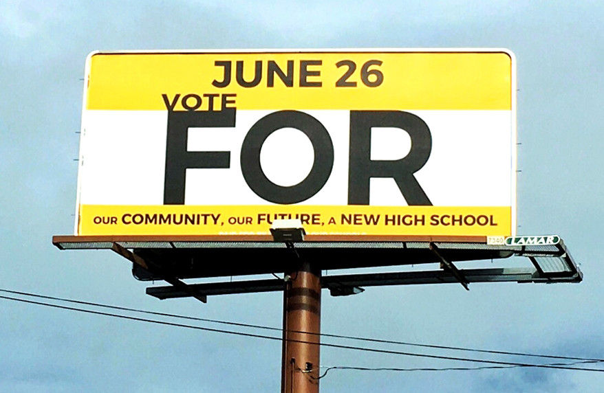 """A BILLBOARD SUPPORTING a proposed property tax increase to pay for a new high school and other facility improvements was paid with a donation from David and Karen Venis, who have three children. The Versailles couple and other Woodford Countians will vote """"For"""" or """"Against"""" a 5.5 cent property tax increase during a special election on Tuesday, June 26. (Photo submitted)"""