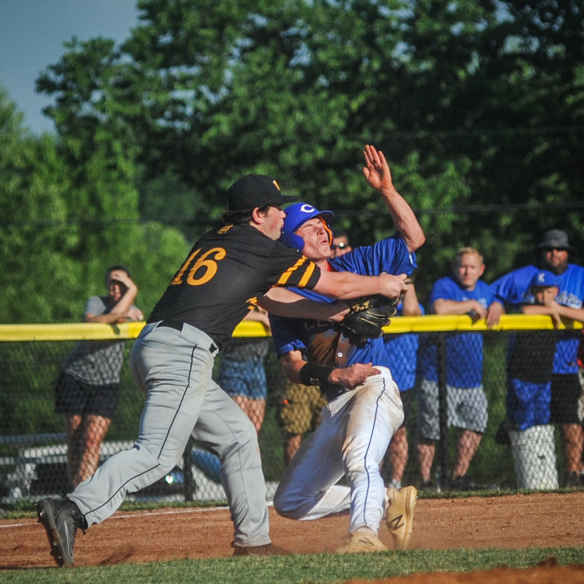 WCHS JUNIOR GRIFFIN BLANKENSHIP tags out a Madison Central runner in the third inning of the Jackets' 4-2 loss in the 11th Region semifinal. (Photo by Bill Caine)