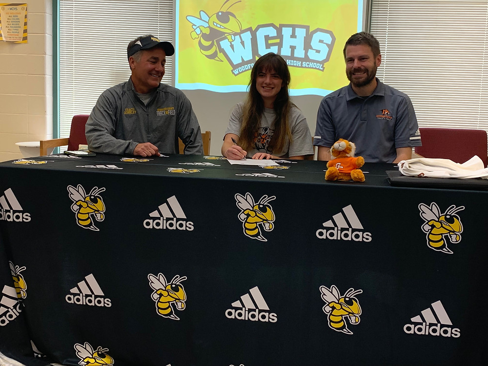 Cutline: WCHS SENIOR ESTHER BRADSHAW (center) committed to Georgetown College Tuesday afternoon. She'll be the third WCHS product on the Georgetown roster for 2019-2020. WCHS Assistant Coach Michael Gormley (left) and Georgetown coach Luke Garnett (right) were in attendance. (Photo by Thomas Mims)