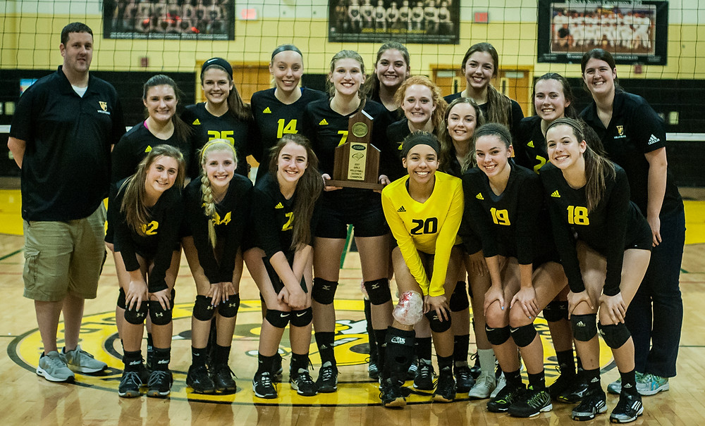 2017 DISTRICT 41 CHAMPIONS Woodford County High School Lady Yellow Jackets. Front row, from left, are Hope Baker, Riley Dawkins, Evelyn Milburn, Karigan Smith, Georgia Sutterlin, and Laura Crutchfield; middle row, Lauren Smiley, Victoria Kupets, and Taylor Holbrook; back row, Chris Thomas (assistant coach), Caroline Miller, Claire Lehmkuhler, Adie Preston, Allison Birch, Piper McCoun, Anna Holt, Meghan Bottom (head coach). (Photo by Bill Caine)