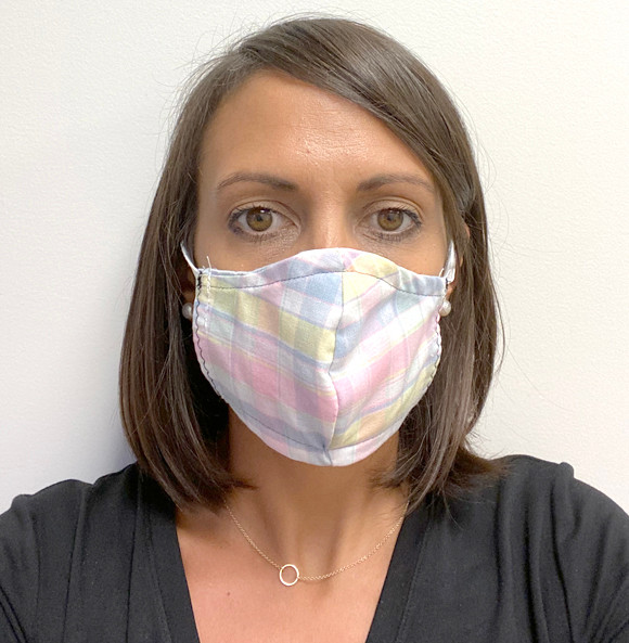 """PUBLIC HEALTH DIRECTOR Cassie Prather is pictured wearing one of a variety of free face masks available at the Woodford County Health Department. """"We just didn't want anybody to encounter a barrier to not wearing a mask,"""" she said. To request a mask for pickup, call 859-753-6519. (Photo submitted)"""