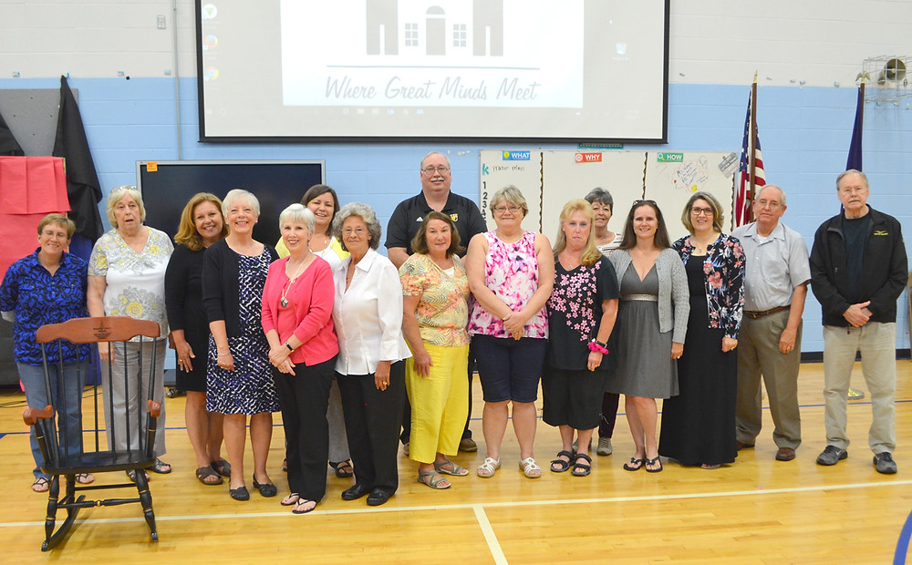 RETIREES GATHERED on Monday night after being recognized by the Woodford County Board of Education for their years of service to students. (Photo by Bob Vlach)