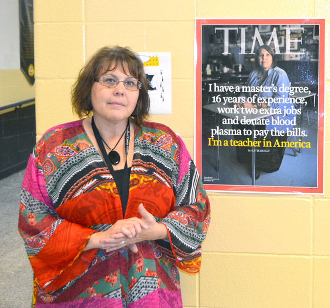 """HOPE BROWN was one of three teachers featured in a Time magazine cover story: """"The Life of the American Teacher,"""" which hits newsstands today. Brown, who teaches civics and U.S. history at Woodford County High School, said science teacher David Graves gave her an enlarged photo of her Time cover. (Photo by Bob Vlach)"""
