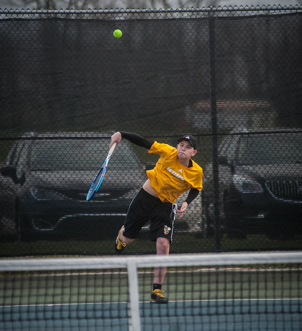 WCHS FRESHMAN EVAN BENTLEY, pictured earlier this season, has had a dominant season in doubles with teammate Mason MnIntyre. The duo won  6-0, 6-1 against Scott County on Monday, April 30.  (File photo by Bill Caine)