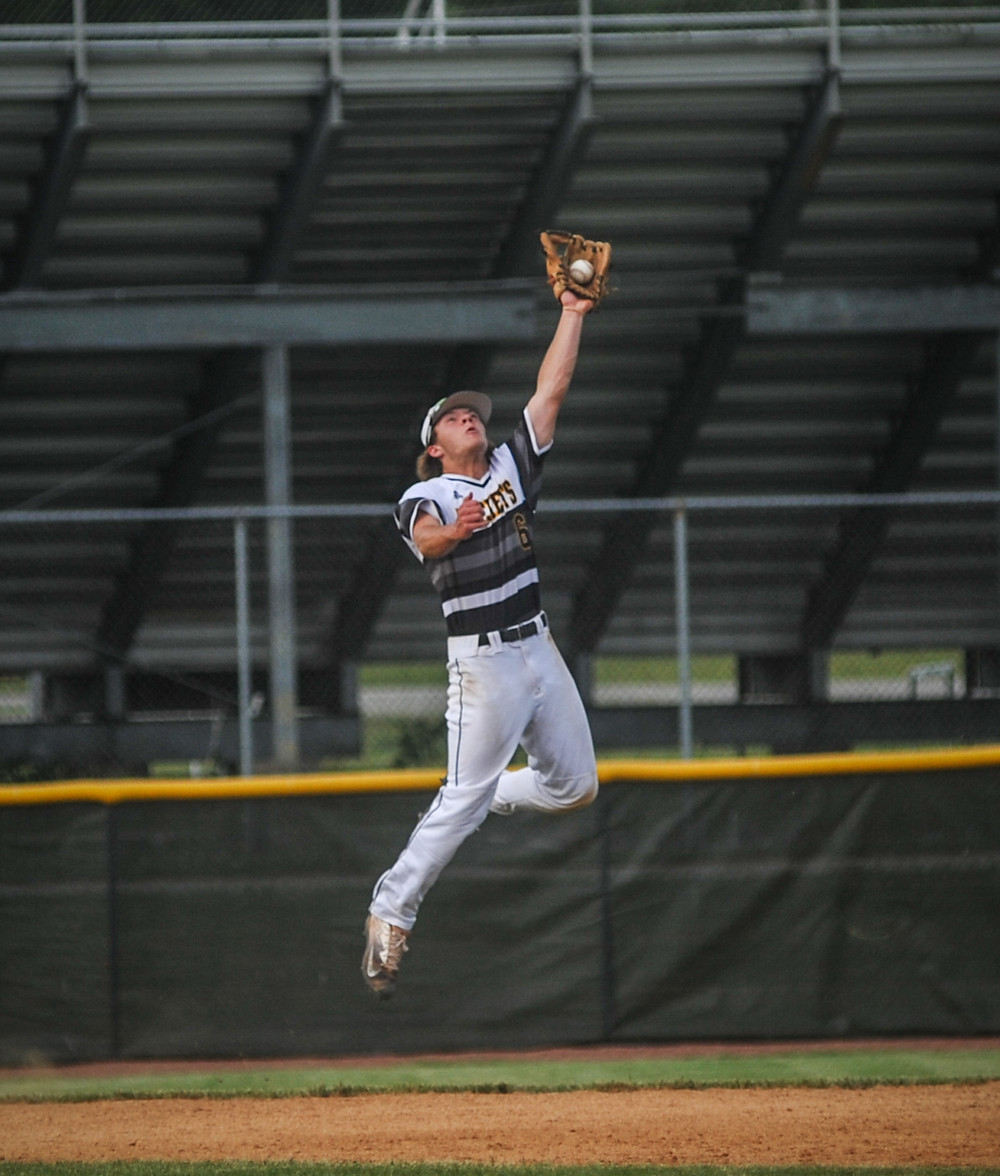 WCHS JUNIOR SHORTSTOP BEN BROWNING makes a leaping catch in the Jackets 10-0 win in the district semifinal on May 21. (Photo by Bill Caine)