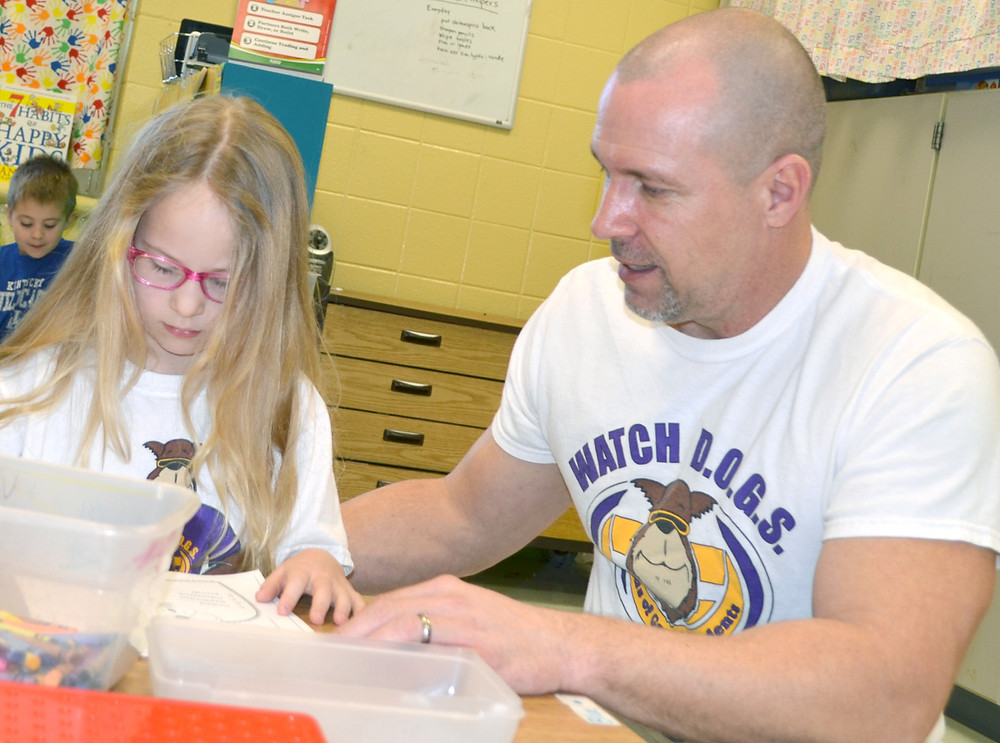 WATCH D.O.G.S. VOLUNTEER Steve Reed likes being a positive role model for students at Northside Elementary School. His six-year-old daughter, Piper, also appreciates having her dad at school. (Photo by Bob Vlach)