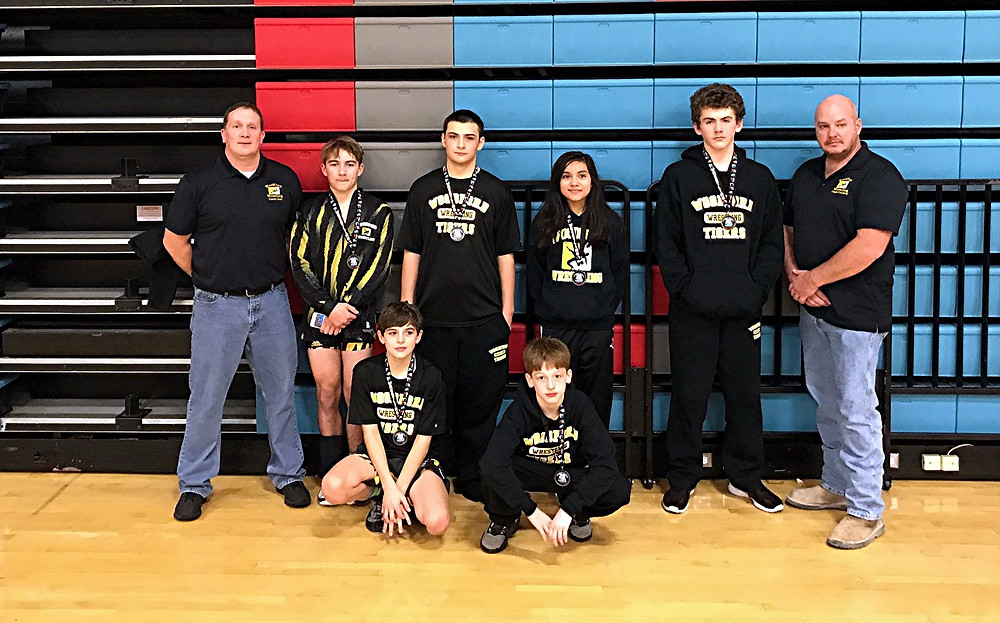 THE WOODFORD COUNTY MIDDLE SCHOOL wrestling team had a number of wrestlers place at the Battle of the Brave tournament at Union County on Saturday, Dec. 17. Team members shown in the photo are, front row, left to right, Andreoni and Dutton; back row, Chris Goss (coach), Jonathan Pittman, Tony Ornelas, Ashley Courtney, Will Smithers, and Brent Courtney (coach). Not pictured are Jarvis Livingston (coach), Jackson Geilear, and Grant Garrison. (Photo by John Pittman)