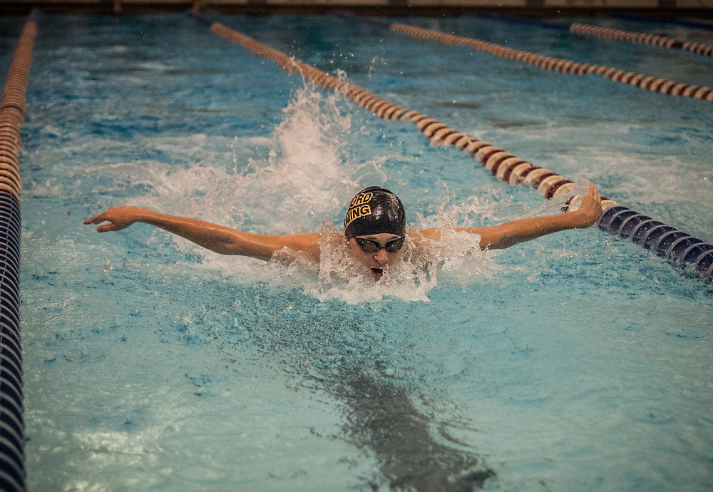 SEVENTH-GRADER DYLAN HARDEE splashes into the pool in the one-meter dive competition on Wednesday, Dec. 6 at Falling Springs. (Photo by Bill Caine)