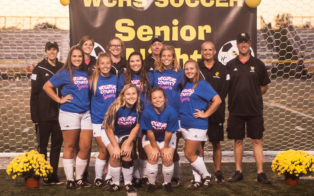 SENIOR NIGHT for the Lady Jackets took place on Sept. 30 at Community Stadium. Front row, from left, are Miranda Carl and Tiffany Royster; middle row, Sydney Beavers, Lauren Rankin, Ashton Moore, Makayla Devore and Kristen Jordan; back row, coaches Lyndsay Vance, Anne-Spicer Adams, Elena Hitch, Craig Boyce, Brad Turpin and Matt Cole. (Photo by Bill Caine)