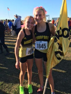 ADDIE MOORE, left, and Maggie Twehues finished in the top-10 to propel the Woodford County High School girls' cross country team to a 6th place finish at the state 3A Cross Country Championship in Bourbon County Oct. 31. Addie finished third with a time of 19:06.20, while Maggie was sixth with a time of 19:38.59. (Photo by Kelly Crume)
