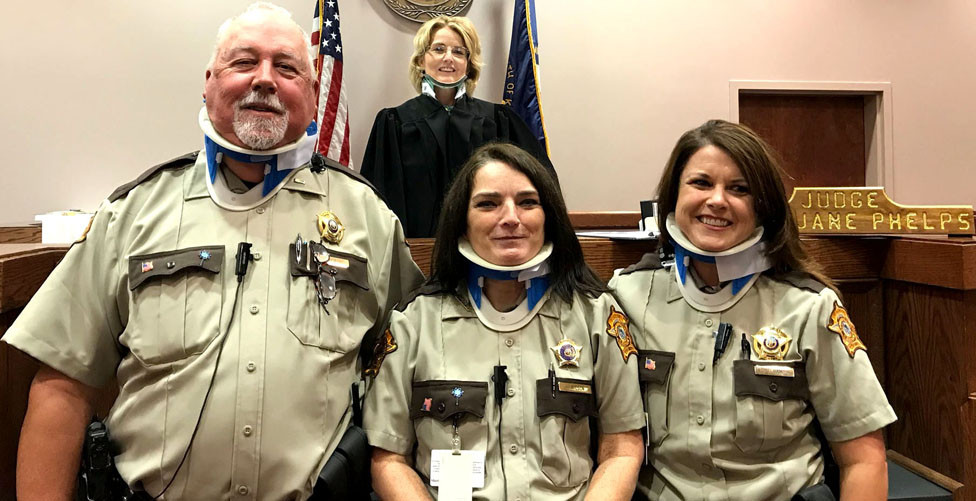 JUDGE MARY JANE PHELPS suffered a broken neck Aug. 16 in a trampoline accident, but that didn't stop Bourbon County bailiffs Myron Hill, Kim Wilson and Traci Ham from teasing her about it. Despite the injury, Phelps, who's been the 14th District judge since 1998, didn't miss a day of work. (Photo submitted)